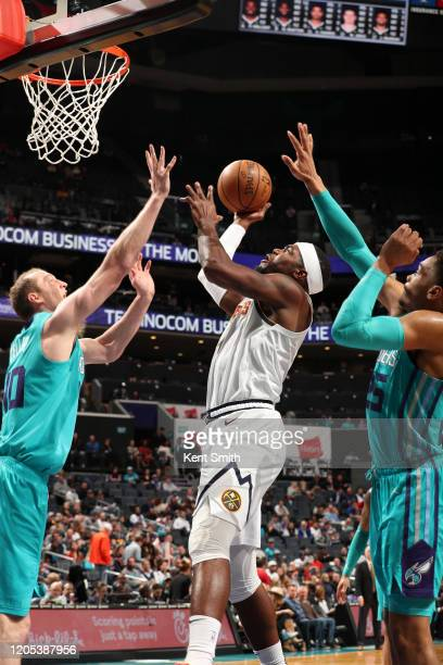 Paul Millsap of the Denver Nuggets shoots the ball against the Charlotte Hornets on March 5 2020 at Spectrum Center in Charlotte North Carolina NOTE...