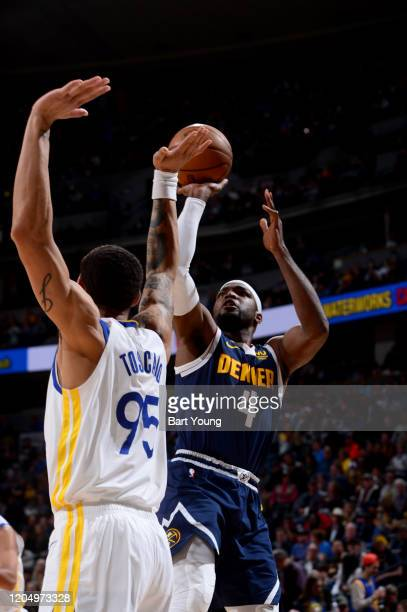 Paul Millsap of the Denver Nuggets shoots the ball during a game against the Golden State Warriors on March 3 2020 at the Pepsi Center in Denver...