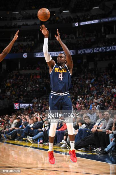 Paul Millsap of the Denver Nuggets shoots three point basket against the Detroit Pistons on February 25 2020 at the Pepsi Center in Denver Colorado...