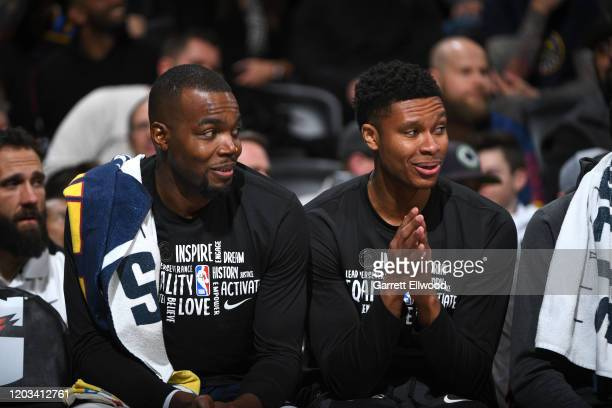 Paul Millsap of the Denver Nuggets talks with PJ Dozier of the Denver Nuggets during the game against the Detroit Pistons on February 25 2020 at the...