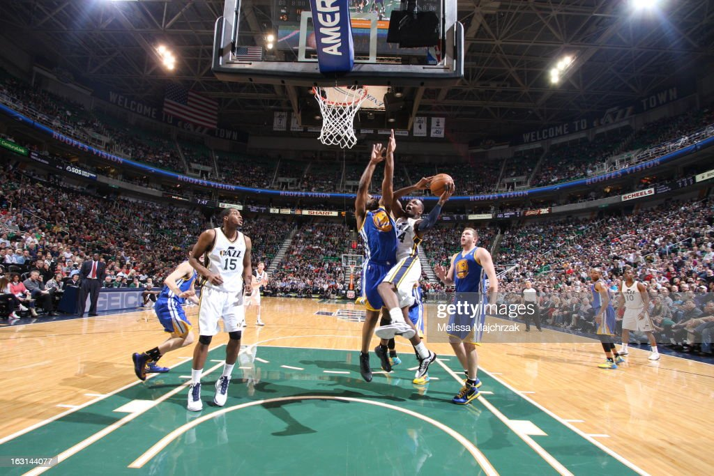 Paul Millsap #24 of the Utah Jazz drives to the basket against the Golden State Warriors at Energy Solutions Arena on February 19, 2013 in Salt Lake City, Utah.