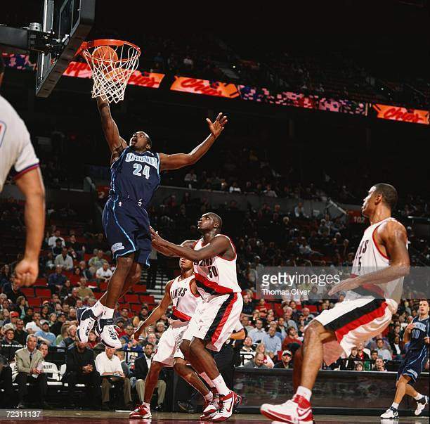 Paul Millsap of the Utah Jazz drives to the basket for a layup past Zach Randolph of the Portland Trail Blazers during a preseason game at The Rose...