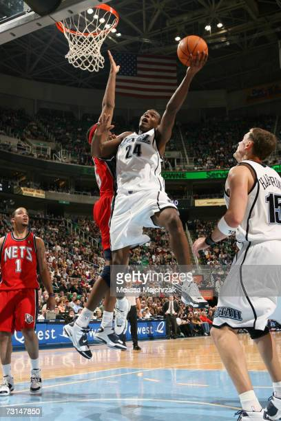 Paul Millsap of the Utah Jazz goes up for the shot against Jason Collins of the New Jersey Nets on January 29 2007 at the EnergySolutions Arena in...