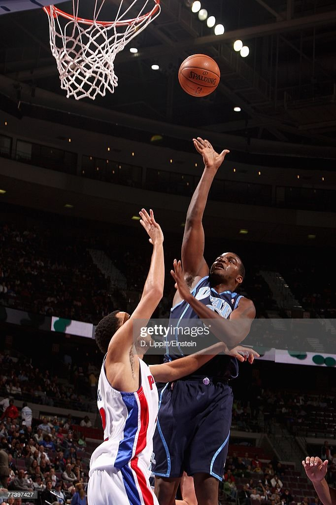 Paul Millsap #24 of the Utah Jazz puts a shot up over Tayshaun Prince #22 of the Detroit Pistons during the game at The Palace of Auburn Hills on October 12, 2007 in Auburn Hills, Michigan. The Jazz won 100-85.