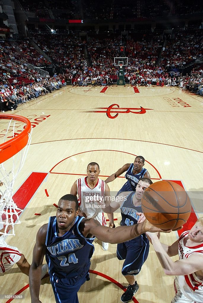 Paul Millsap #24 of the Utah Jazz shoots against Chase Budinger #10 of the Houston Rockets during the game at Toyota Center on April 7, 2010 in Houston, Texas. The Rockets won 00-00.