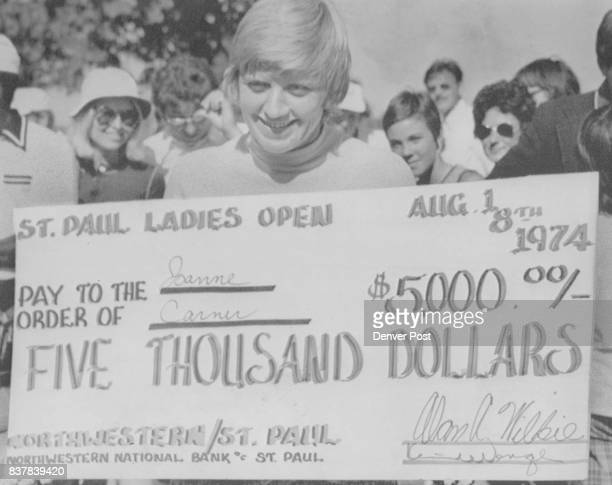 ST Paul Minn Aug 19With The SpoilsJo Anne Carner of Lake Worth Fla holds the check for the $5000 first prize after winning the St Paul Ladies Open...