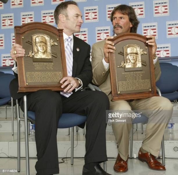 Paul Molitor and Dennis Eckersley sit with their induction plaques after being inducted into the National Baseball Hall of Fame on July 25, 2004 at...
