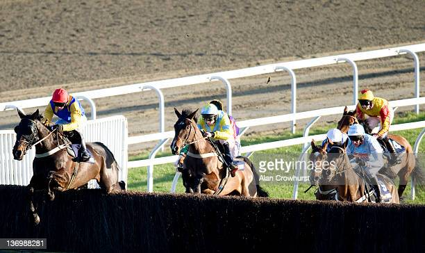 Paul Moloney riding Moleskin on their way to winning The williamhillcom Novices' Handicap Steeple Chase at Kempton racecourse on January 14 2012 in...
