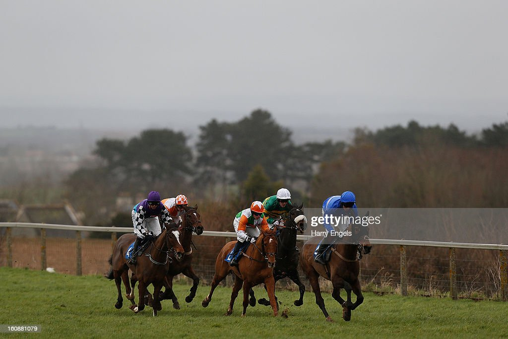 Paul Moloney riding Tornado in Milan (R) leads during the Bathwick Tyres Novices' Handicap Hurdle Race at Taunton Racecourse on February 7, 2013 in Taunton, England.