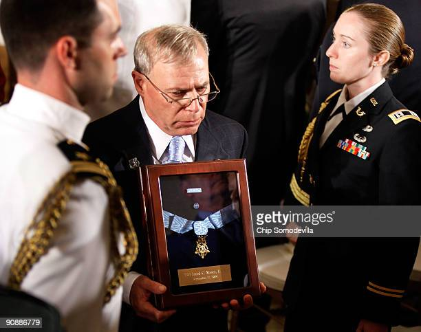 Paul Monti carries the Medal of Honor that was posthumously awarded to his son US Army Sergeant First Class Jared C Monti after a ceremony in the...