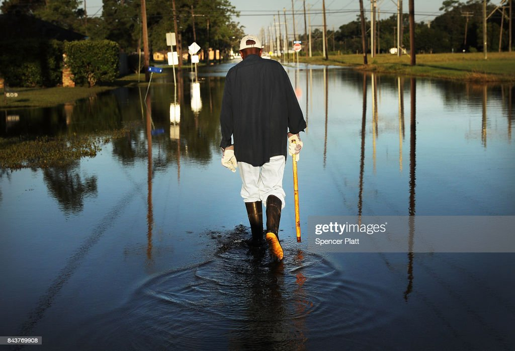 Paul Morris checks on neighbors homes in a flooded district of Orange as Texas slowly moves toward recovery from the devastation of Hurricane Harvey on September 7, 2017 in Orange, Texas. Almost a week after Hurricane Harvey ravaged parts of the state, some neighborhoods still remained flooded and without electricity. While downtown Houston is returning to business, thousands continue to live in shelters, hotels and other accommodations as they contemplate their future.