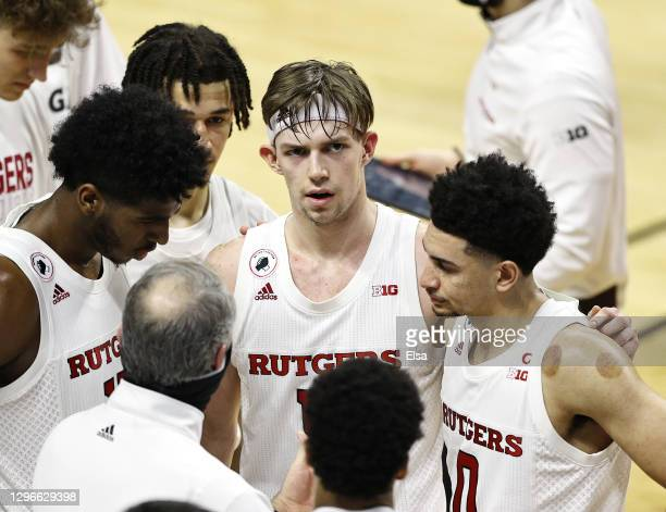 Paul Mulcahy and Geo Baker of the Rutgers Scarlet Knights react in the final minutes of the game against the Wisconsin Badgers at Rutgers Athletic...