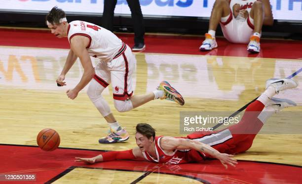 Paul Mulcahy of the Rutgers Scarlet Knights gets ready to scoop up a loose ball and dunk as Jimmy Sotos of the Ohio State Buckeyes dives during the...