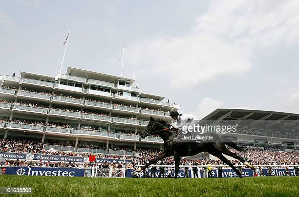 Paul Mulrennan riding Dandino wins the Investec Vincent O'Brien Stakes race during the Investec Derby Festival at Epsom racecourse on June 5 2010 in...