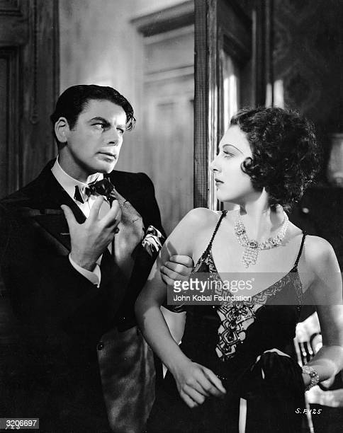 Paul Muni as ruthless gangster Tony Camonte and Ann Dvorak as his sister Cesca in the gangster film 'Scarface' directed by Richard Rosson and Howard...