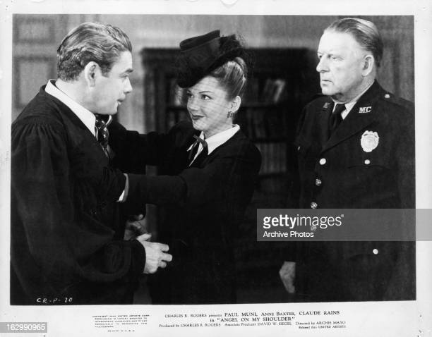 Paul Muni greets Anne Baxter in a scene from the film 'Angel On My Shoulder' 1946