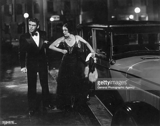 Paul Muni pulls Ann Dvorak roughly by the arm in a scene from the United Artists gangster film 'Scarface' directed by Howard Hawks
