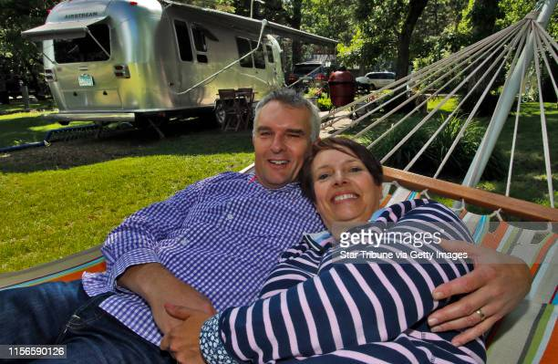 Paul Munro left and wife Caroline Munro outside their Airstream ] Profile of Airstream trailer owners camped at Minnesota Airstream Park near Clear...