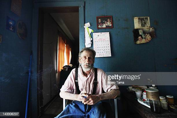 Paul Neace sits in his home in Owsley County on April 20 2012 in Booneville Kentucky Daniel Boone once camped in the Appalachian mountain hamlet of...
