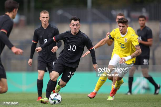 Paul Nebel from U20 Germany and Andrei Marginean of U20 Romania compete for the ball during the International Friendly match between Germany U20 and...