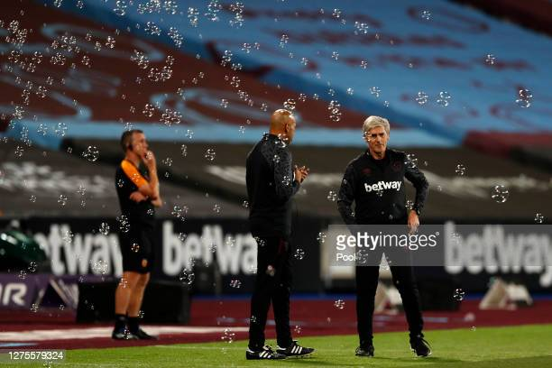 Paul Nevin and Alan Irvine , West Ham coach and Assistant manager look on during the Carabao Cup Third Round match between West Ham United and Hull...