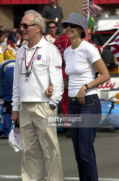 Paul Newman and Ashley Judd enjoy a moment prior to the race