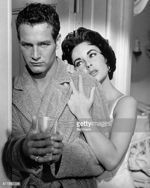 "Paul Newman and Elizabeth Taylor in the 1958 MGM version of the Tennessee Williams play ""Cat on a Hot Tin Roof."""