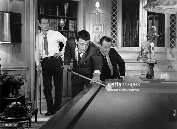 Paul Newman and George C Scott look on as Murray Hamilton takes a shot in a scene from the 20th CenturyFox production of The Hustler in 1961 in Los...