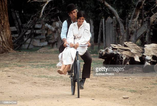 Paul Newman and Katharine Ross double riding on a bicycle in a scene from the film 'Butch Cassidy and the Sundance Kid' 1969