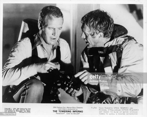 Paul Newman and Steve McQueen get ready to blow up water storage tanks in a scene from the film 'The Towering Inferno' 1974