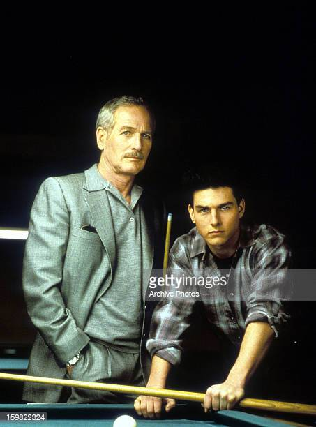 Paul Newman and Tom Cruise standing at a pool table in a scene from the film 'The Color Of Money', 1986.