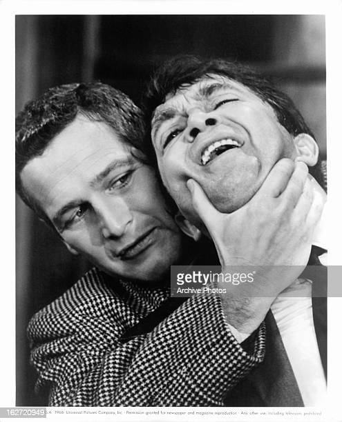 Paul Newman grabbing the face of Wolfgang Kieling in a scene from the film 'Torn Curtain' 1966