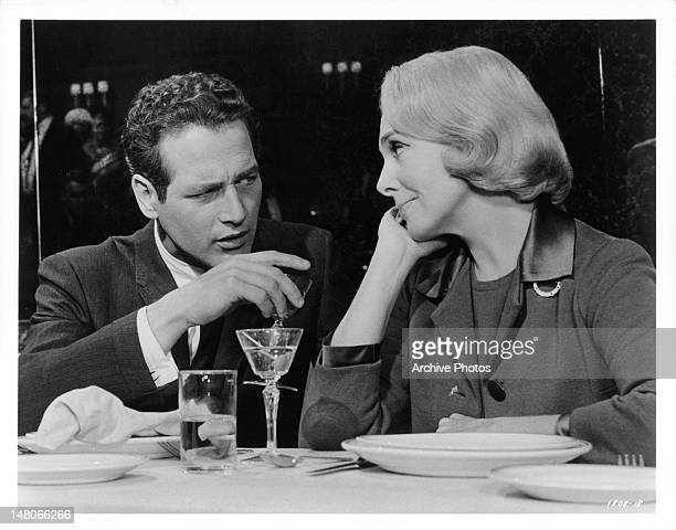 Paul Newman hears from Micheline Presle the plan for making her husband jealous in a scene from the film 'The Prize' 1963