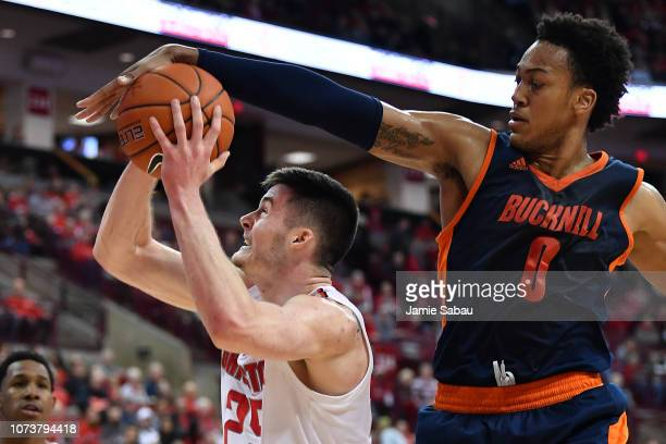 Paul Newman of the Bucknell Bisons defends against a shot attempt by Kyle Young of the Ohio State Buckeyes in the first half on December 15, 2018 at...