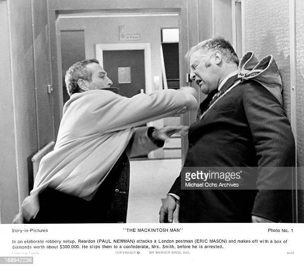 Paul Newman punches Eric Mason in a scene from the film 'The MacKintosh Man', 1973.