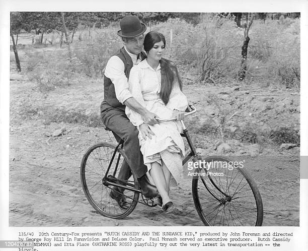Paul Newman riding bike with Katharine Ross in a scene from the film 'Butch Cassidy And The Sundance Kid' 1969