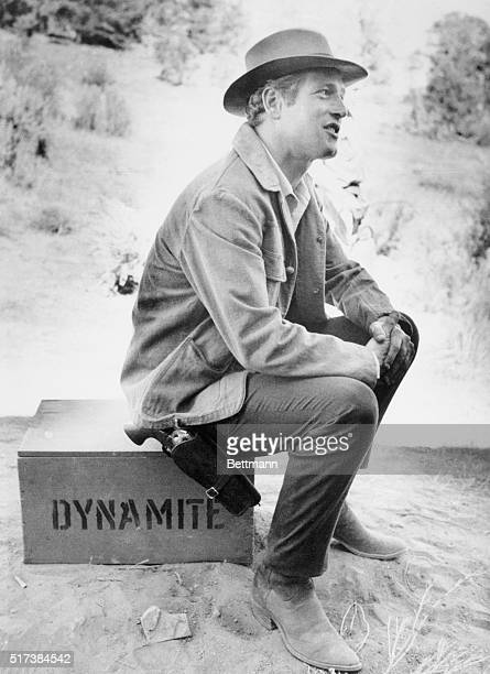 Paul Newman sits on a case of dynamite used on the set of his new film Butch Cassidy and the Sundance Kid during a break on location in western Utah