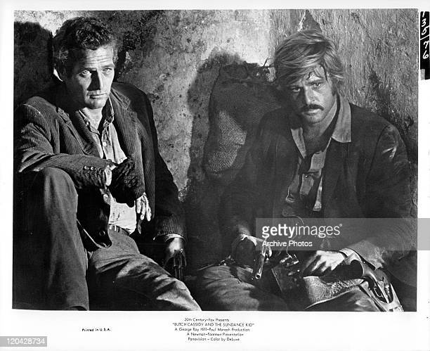 Paul Newman sitting with Robert Redford in a scene from the film 'Butch Cassidy And The Sundance Kid' 1969