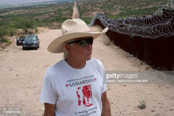 Paul Nixon a volunteer with Green ValleySahuarita Samaritans observes the border fence in Sasabe Arizona on July 14 2019 Volunteers of the Green...