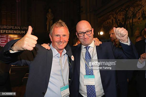 Paul Nuttal MEP and Nigel Evans MP of Vote Leave celebrate as positive results come in from the counts before the official referendum announcement at...
