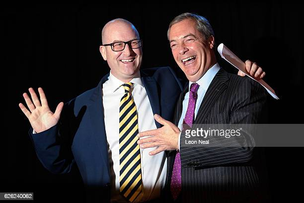 Paul Nuttall is congratulated by former UKIP leader Nigel Farage after being named as the new party leader on November 28 2016 in London England The...