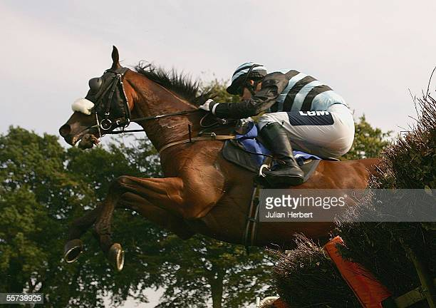Paul O' Neill and Sheer Guts clear an early flight before landing The Louis Latour Seling Handicap Hurdle Race run at Fontwell Racecourse on Septeber...
