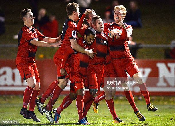 Paul O'Brien of Redlands United celebrates scoring a goal with his team mates in extra time during the FFA Cup round of 32 match between Redlands...