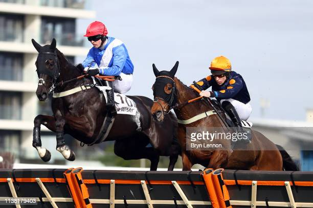 Paul O'Brien riding Fanzio clears the final hurdle in The Be Wiser Insurance Junvenile Handicap Hurdle race at Newbury Racecourse on March 23 2019 in...