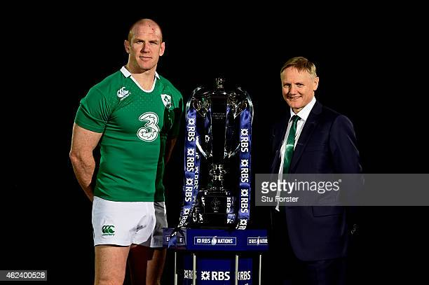 Paul O'Connell of Ireland and Joe Schmidt the coach of Ireland pose with the trophy during the launch of the 2015 RBS Six Nations at the Hurlingham...