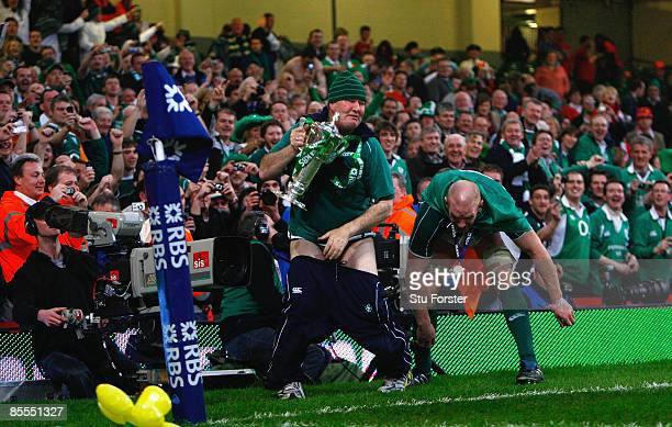 Paul O'Connell of Ireland jokes around with a member of the Ireland team's support staff after winning the Grand Slam during the RBS 6 Nations...