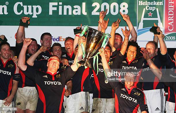 Paul O'Connell of Munster and Ronan O'Gara of Munster lift the trophy after the Heineken Cup Final between Munster and Toulouse at the Millennium...