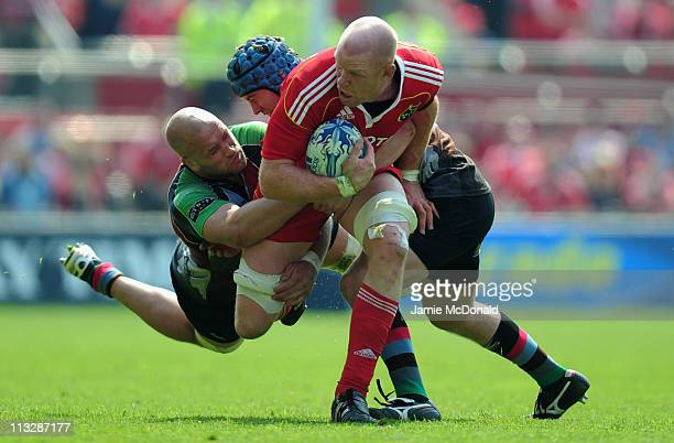 Paul O'Connell of Munster is tackled by Joe Marler of Harlequins during the Amlin Cup semi-final match between Munster and Harlequins at Thomond Park...