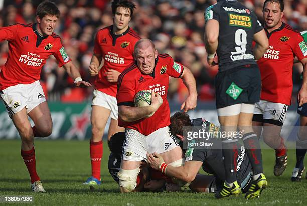 Paul O'Connell of Munster is tackled during the Heineken Cup match between Munster and Scarlets at Thomond Park on December 18 2011 in Limerick...