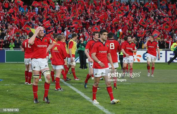 Paul O'Connell the Munster captain and players walk off the pitch after their defeat during the Heineken Cup semi final match between Clermont...